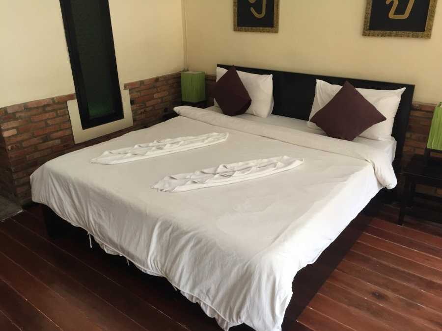 Bed inside a double room at Motive Cottage Resort in Khao Lak