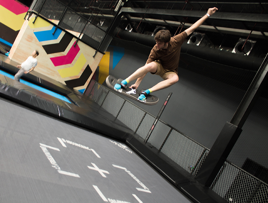 A customer shows off his skills with a soft board on the super trampline at Bounce Thailand in Bangkok