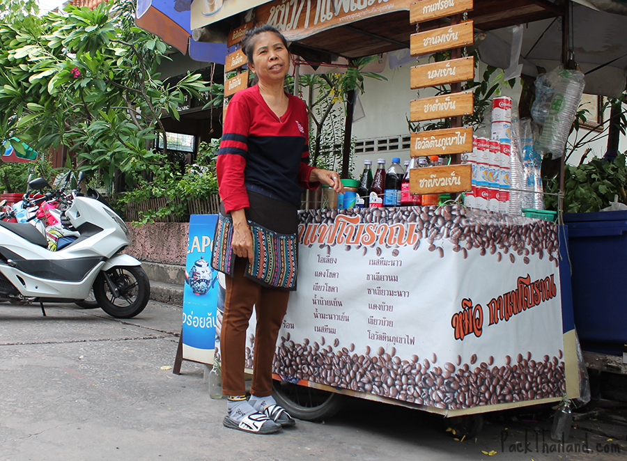 An old lady selling drinks inside the temple grounds
