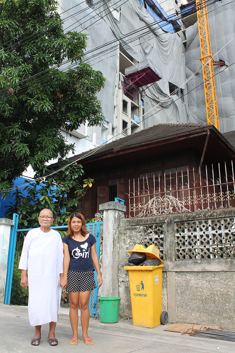 Kannika Chomsiri, 79, and her daughter Sununta, 39, outside the family home that developers offered to buy for 85million thb