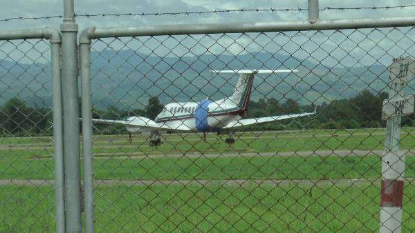 The plane with a plastic sheet covering the place where its door fell off