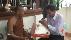 The plane's pilot Prasart Inyim asks a monk for the door back