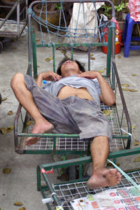 A Thai sleeping on a trolley at Chatuchak weekend market