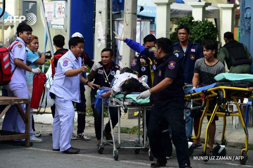 A injured woman is carried away after a second wave of Thailand bombs in Hua Hin