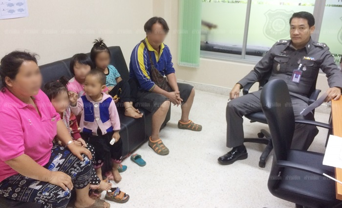 The parents with their two daughters at the local police station