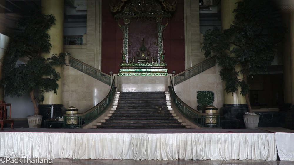 The ornate lobby of the Grand Ayudhaya with marble floors and trees which have been maintained